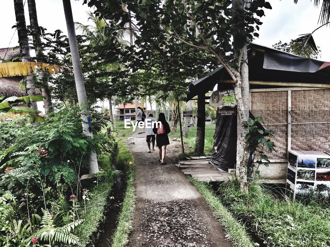 walking, architecture, tree, real people, built structure, full length, building exterior, one person, day, outdoors, lifestyles, men, nature, grass, people, adult