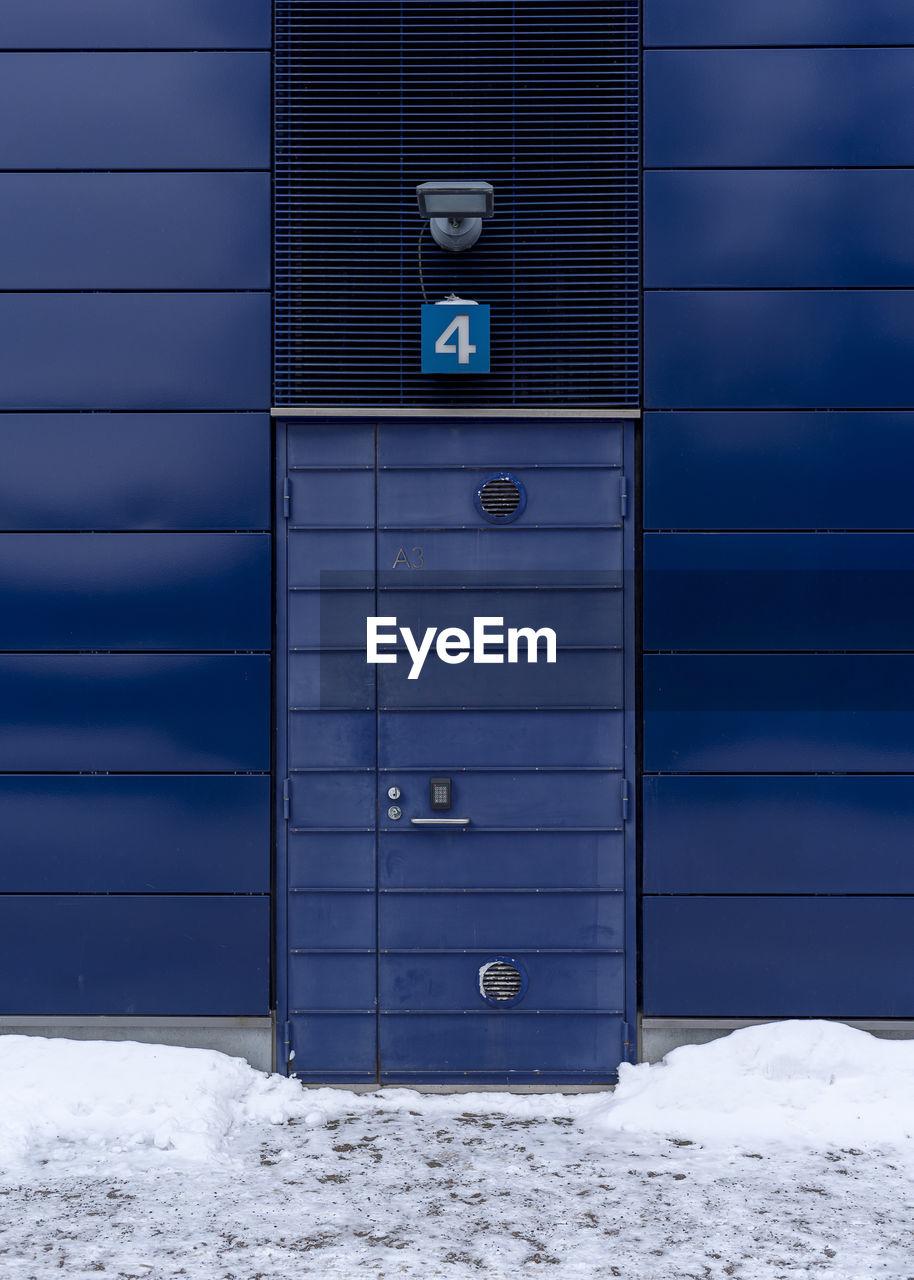 Closed Door Of Warehouse During Winter