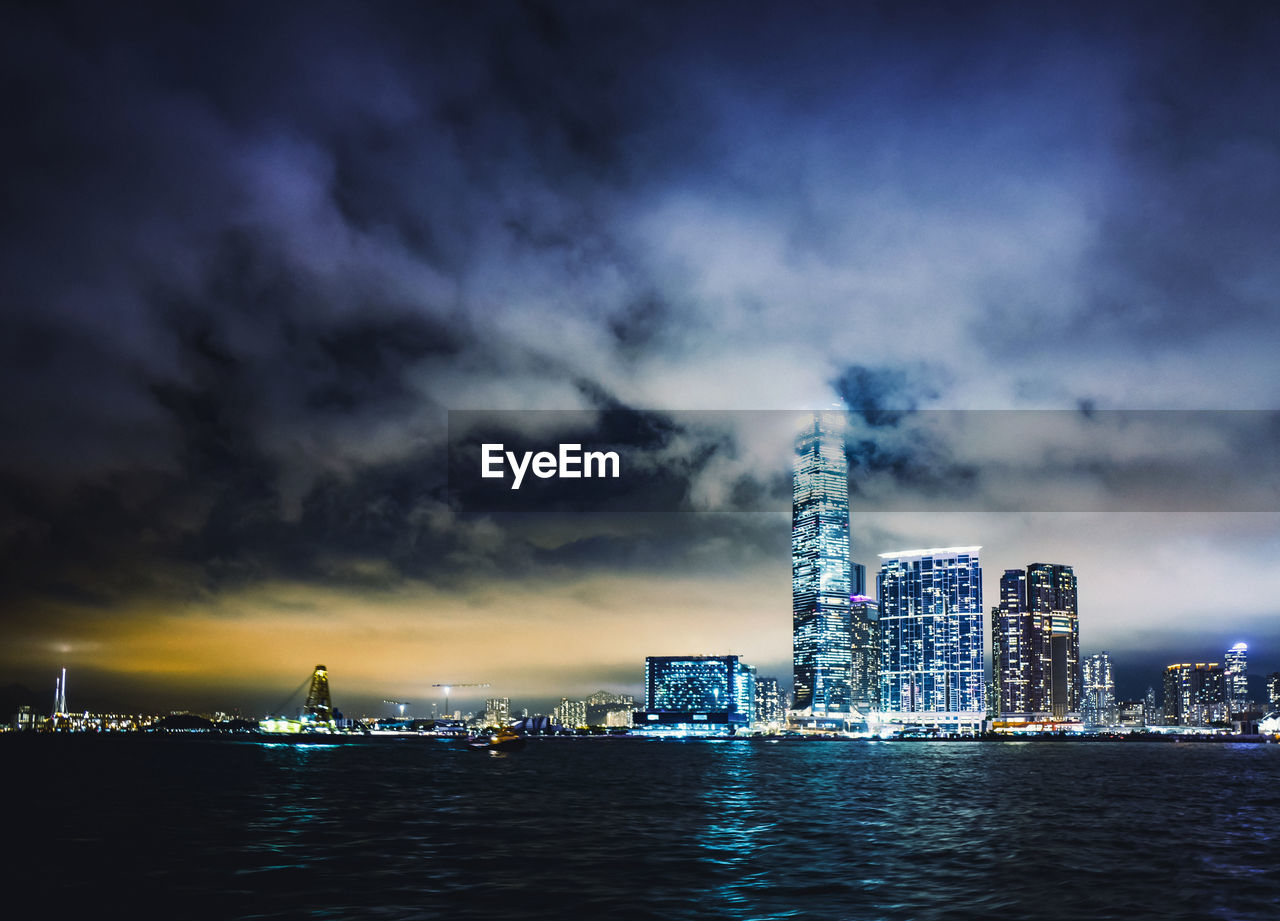 architecture, building exterior, built structure, sky, water, waterfront, office building exterior, city, cloud - sky, building, skyscraper, nature, tall - high, cityscape, illuminated, modern, sea, no people, night, outdoors, financial district, bay