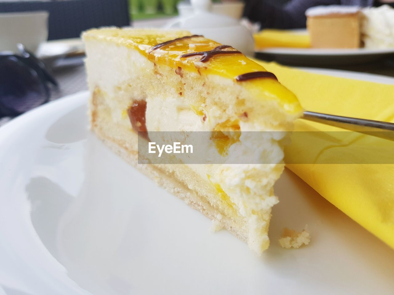 food and drink, food, plate, sweet food, indulgence, freshness, sweet, ready-to-eat, dessert, still life, cake, temptation, close-up, eating utensil, serving size, indoors, slice of cake, baked, slice, kitchen utensil, no people, cheesecake, snack