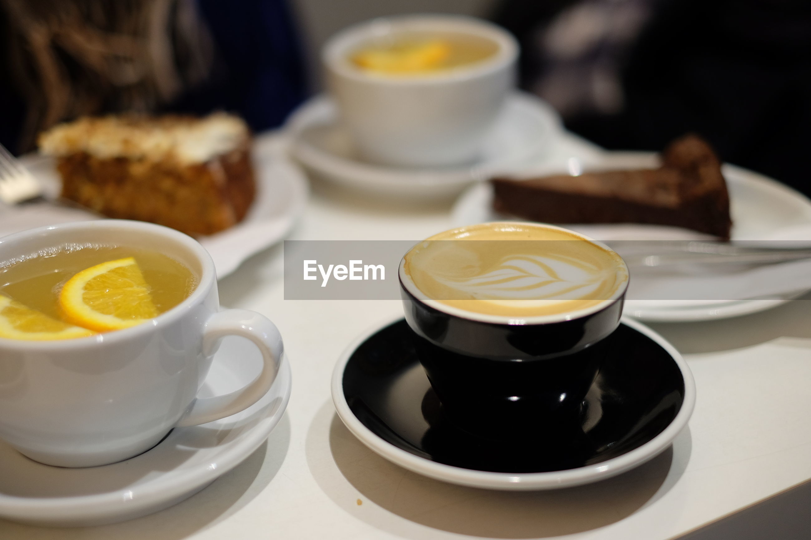 High angle view of coffee and tea cup with cake on table