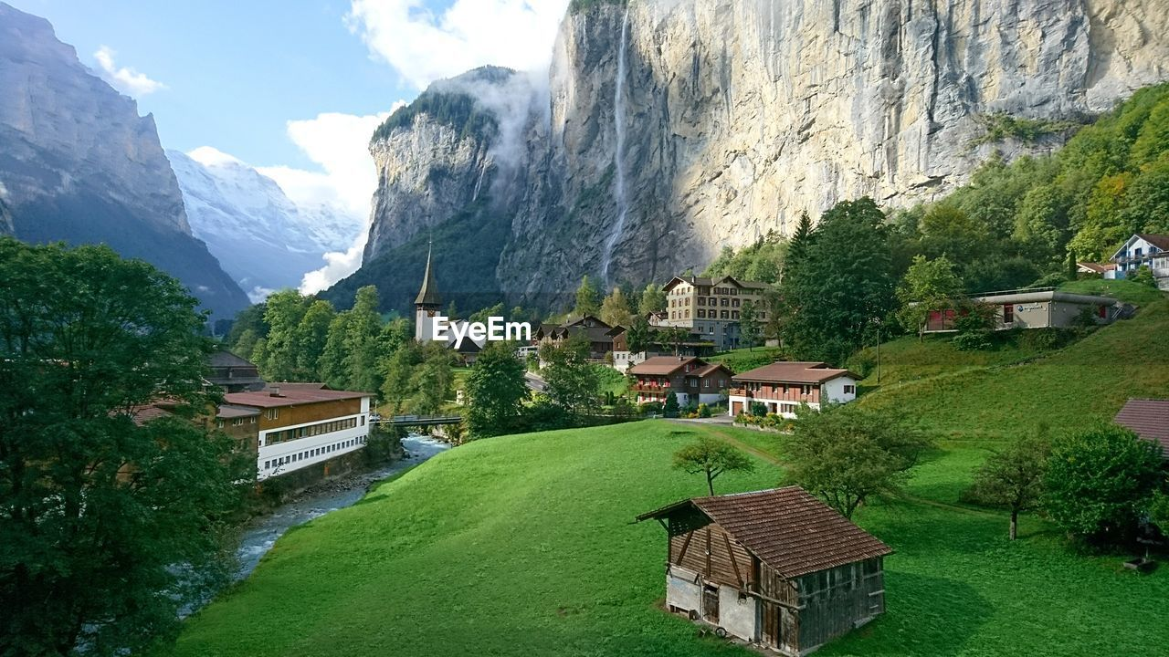 mountain, building exterior, architecture, built structure, house, mountain range, beauty in nature, day, nature, landscape, outdoors, sky, no people, scenics, tree