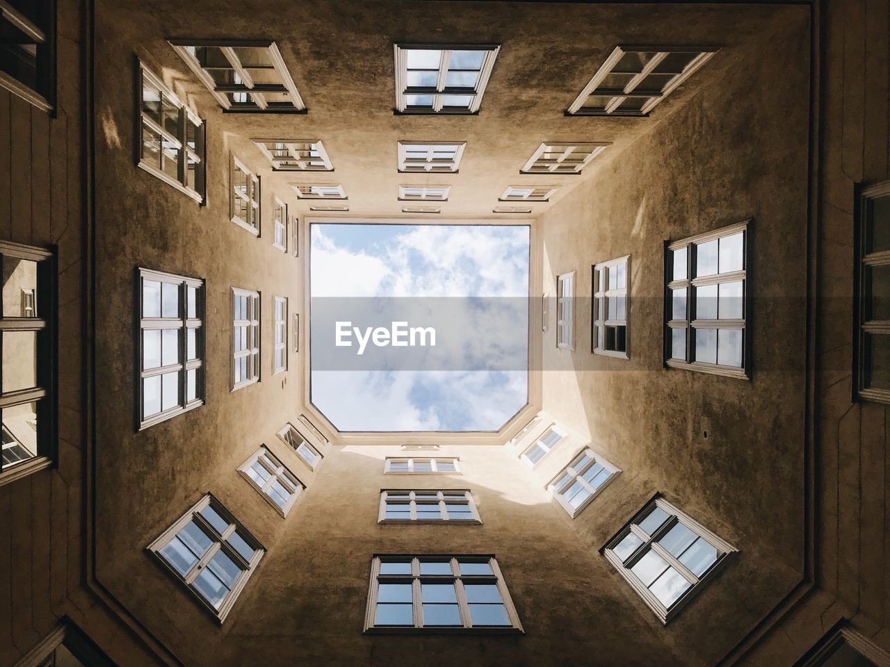 window, architecture, built structure, cloud - sky, building exterior, sky, day, building, no people, nature, glass - material, outdoors, sunlight, geometric shape, directly below, residential district, shape, apartment, low angle view, skylight, digital composite