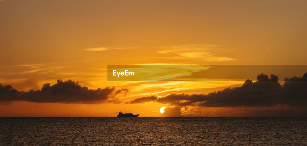 sky, sunset, cloud - sky, water, beauty in nature, scenics - nature, sea, orange color, horizon over water, waterfront, tranquility, horizon, tranquil scene, idyllic, silhouette, nautical vessel, nature, transportation, no people, outdoors