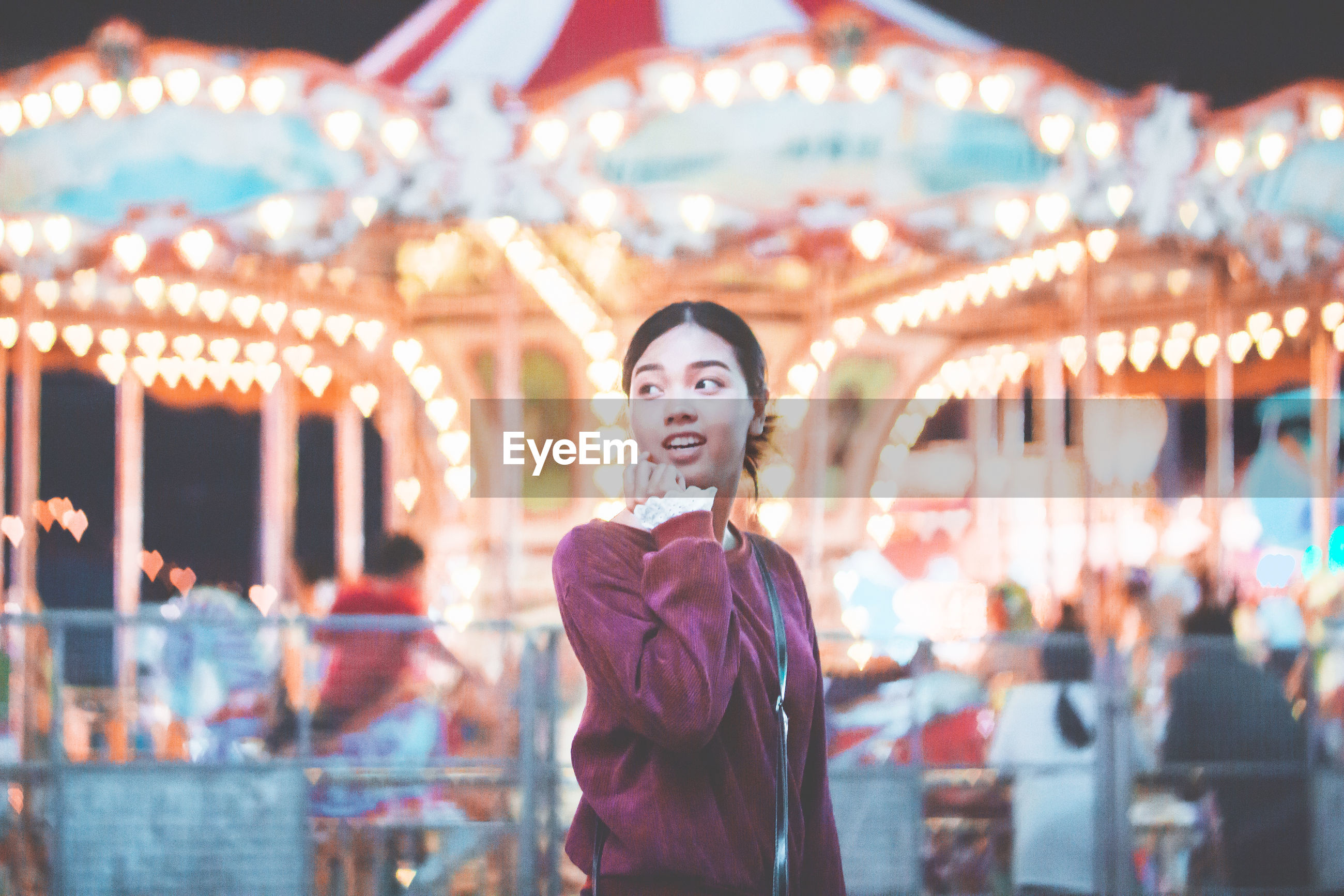 Young woman standing at amusement park