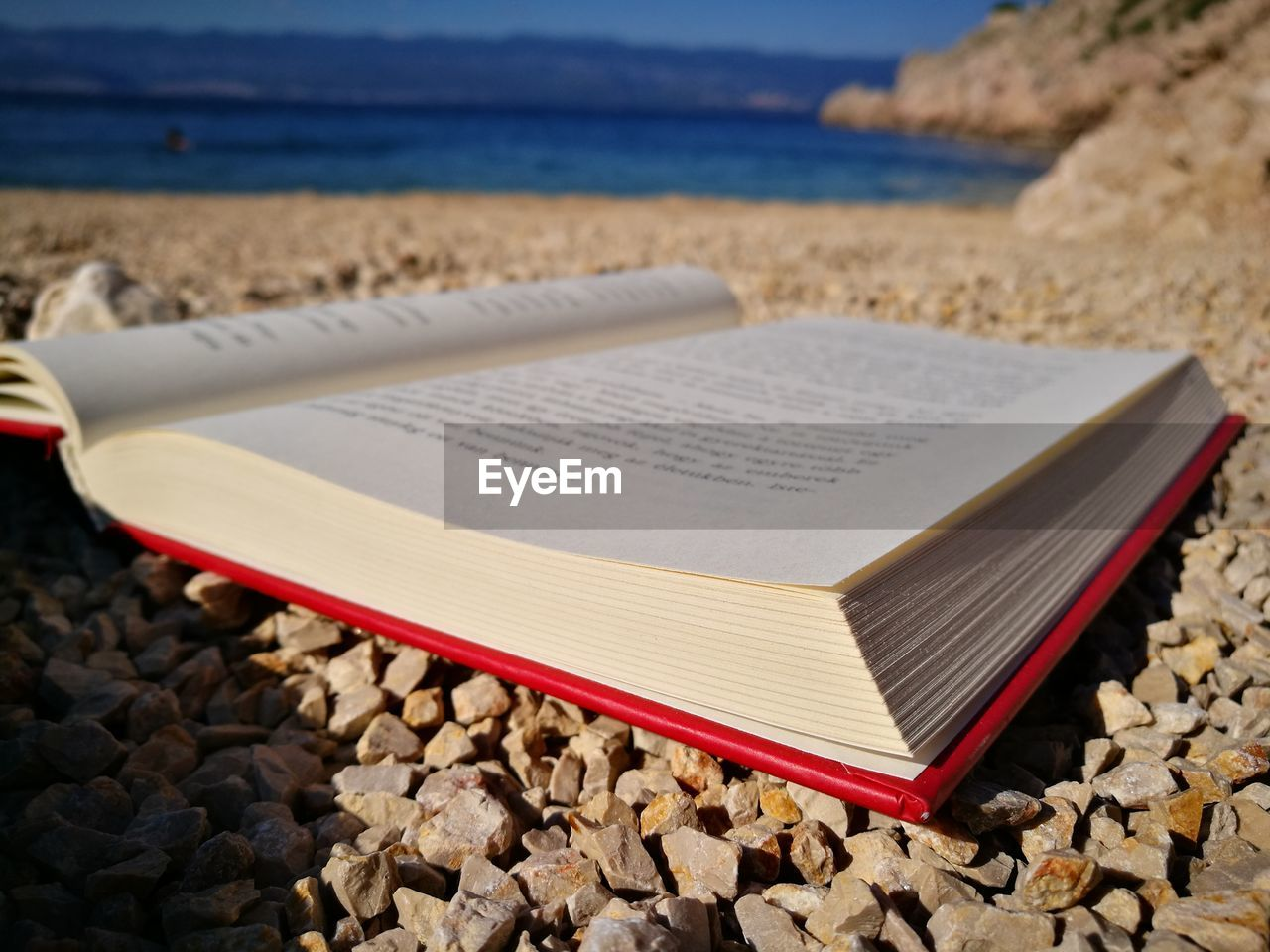 Close-Up Of Book On Beach