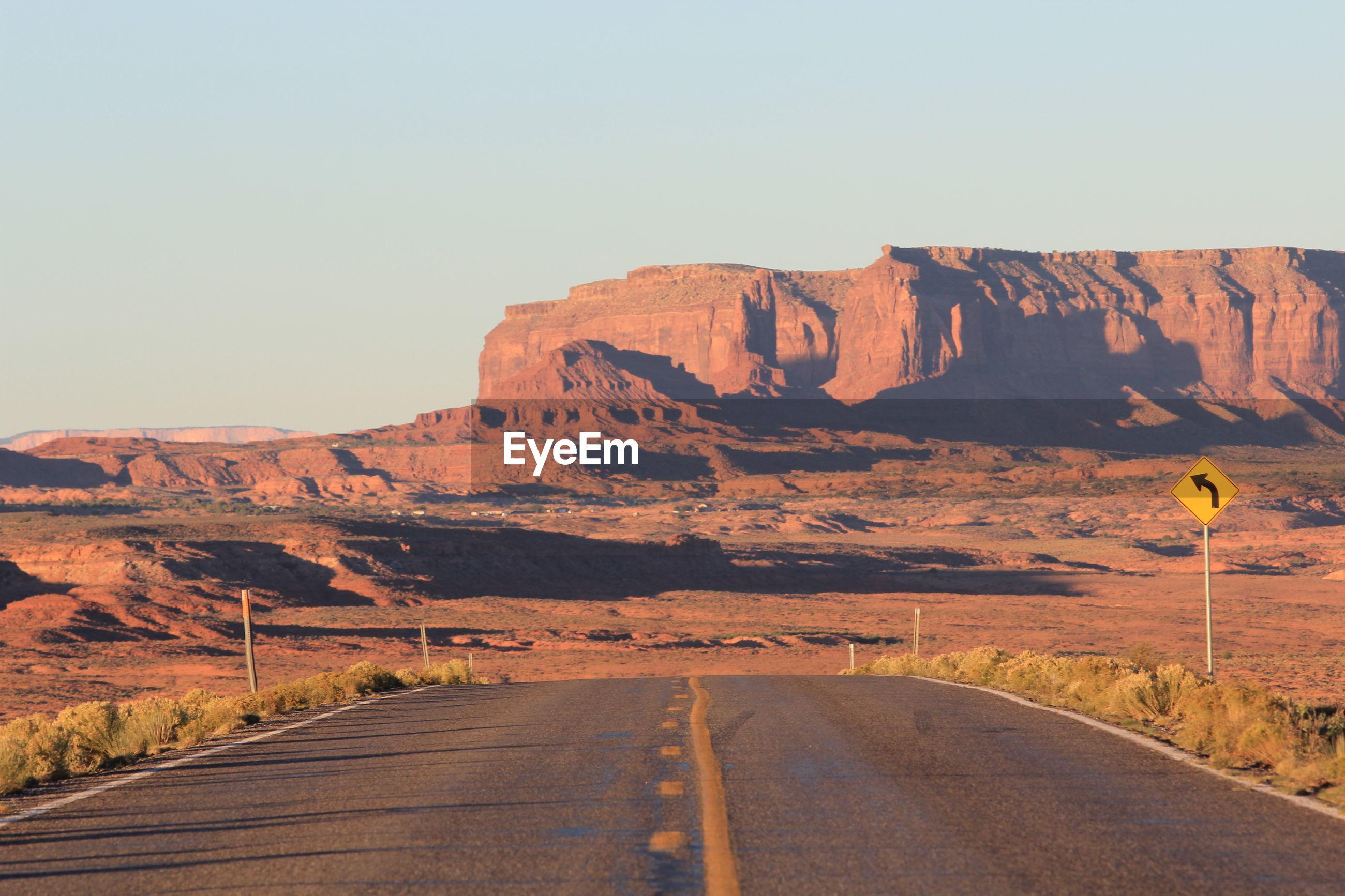 Empty road passing through mountain
