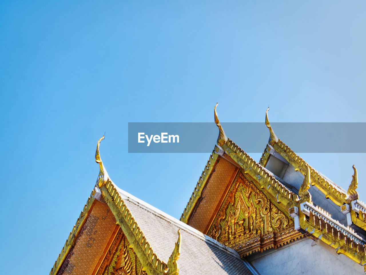 LOW ANGLE VIEW OF TEMPLE AGAINST BUILDING AGAINST CLEAR SKY