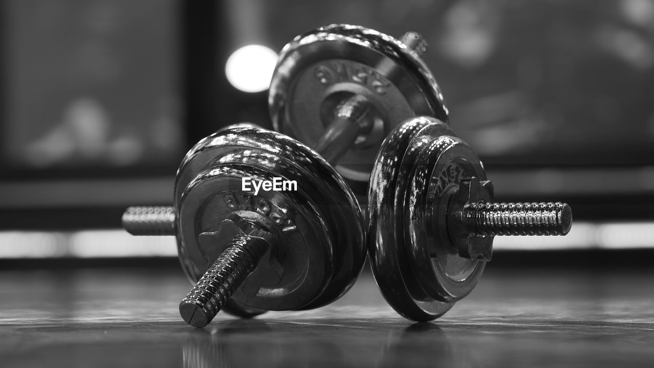Close-up of dumbbells on floor
