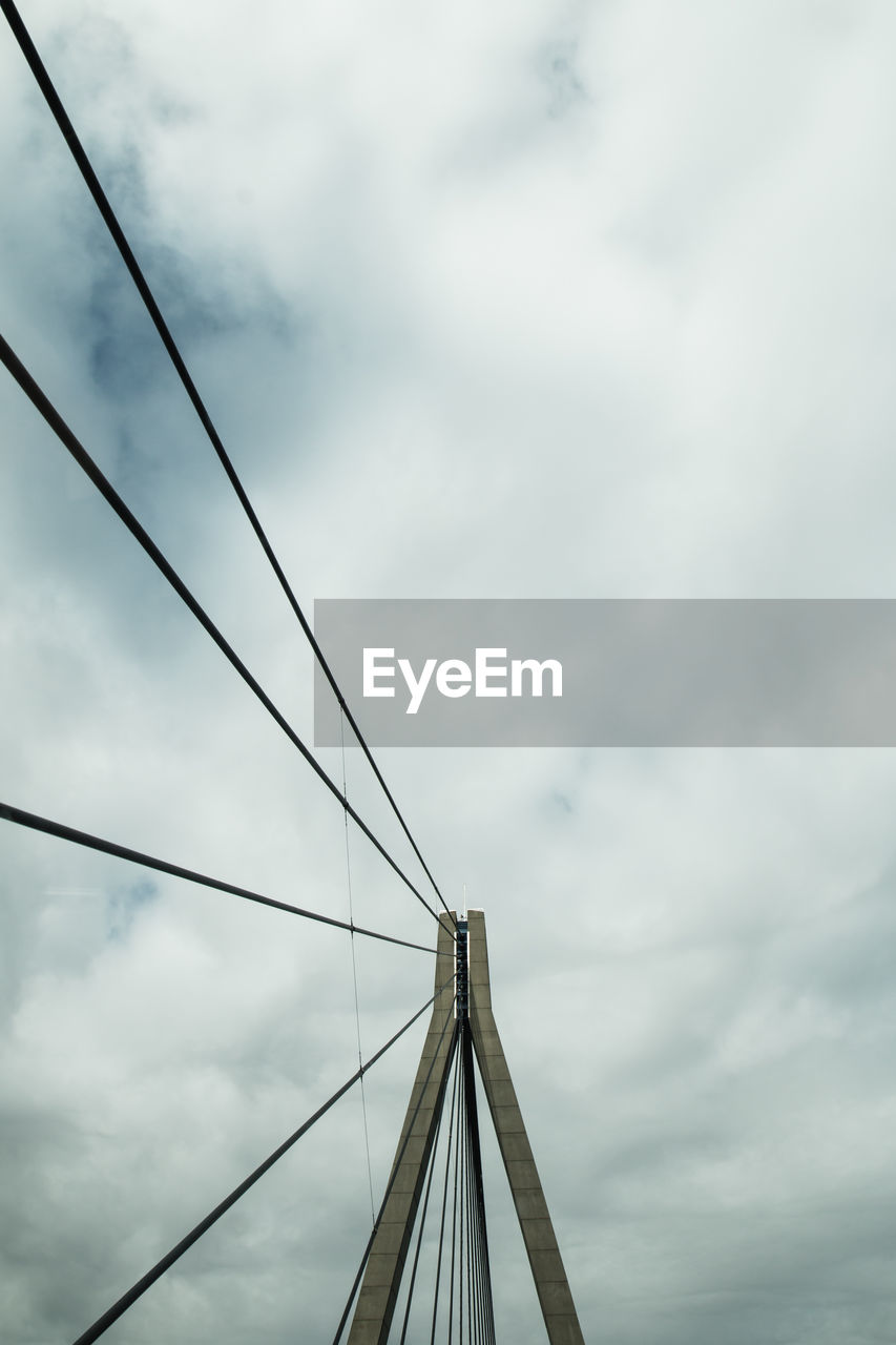 Low Angle View Of Cables On Suspension Bridge