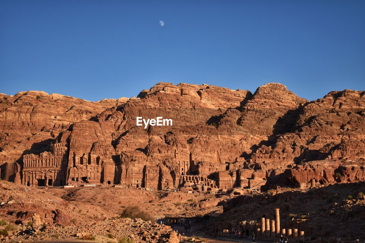 View Of Rock Formations Against Blue Sky