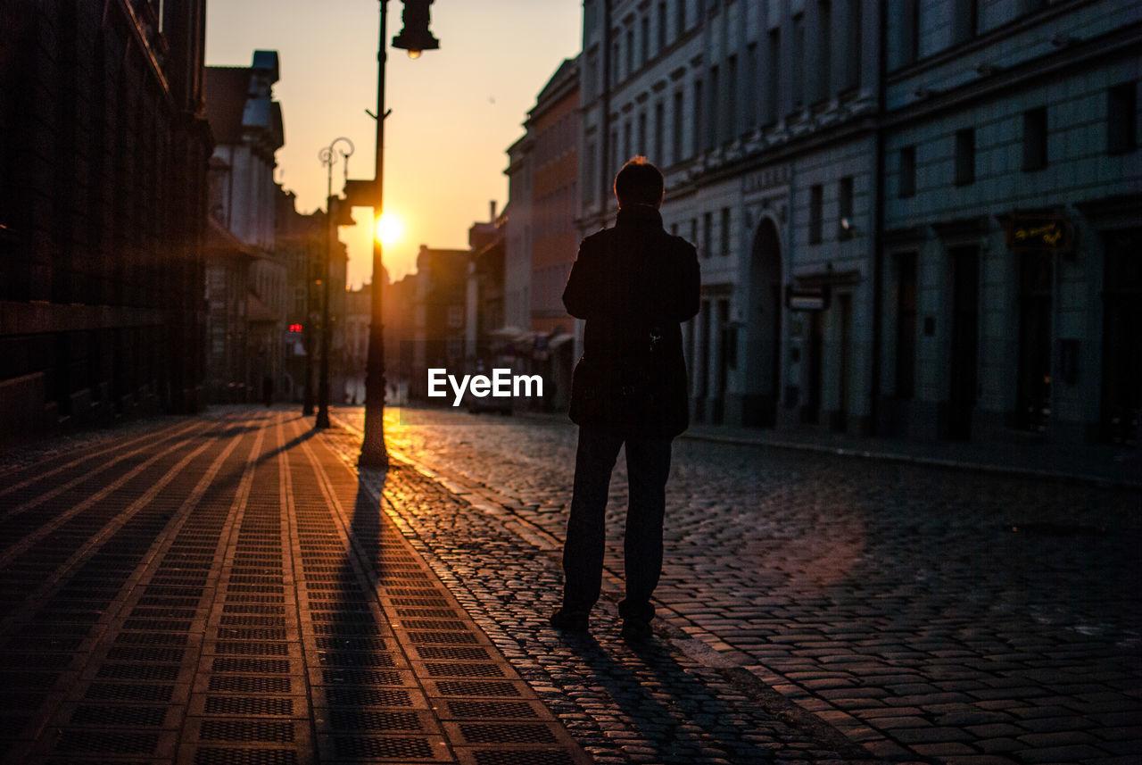 Rear View Of Man On Street