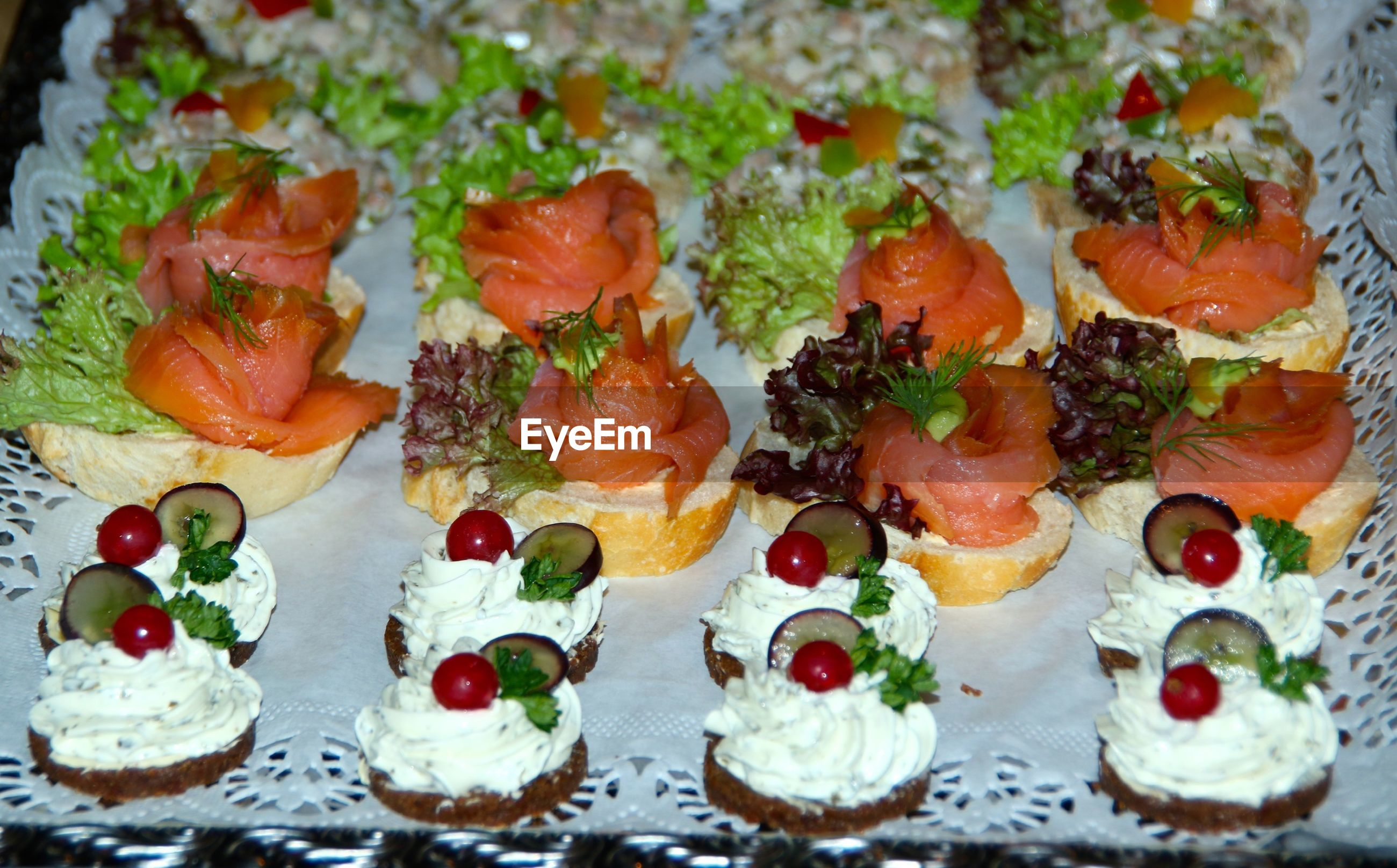 High angle view of salmon canapes on tray