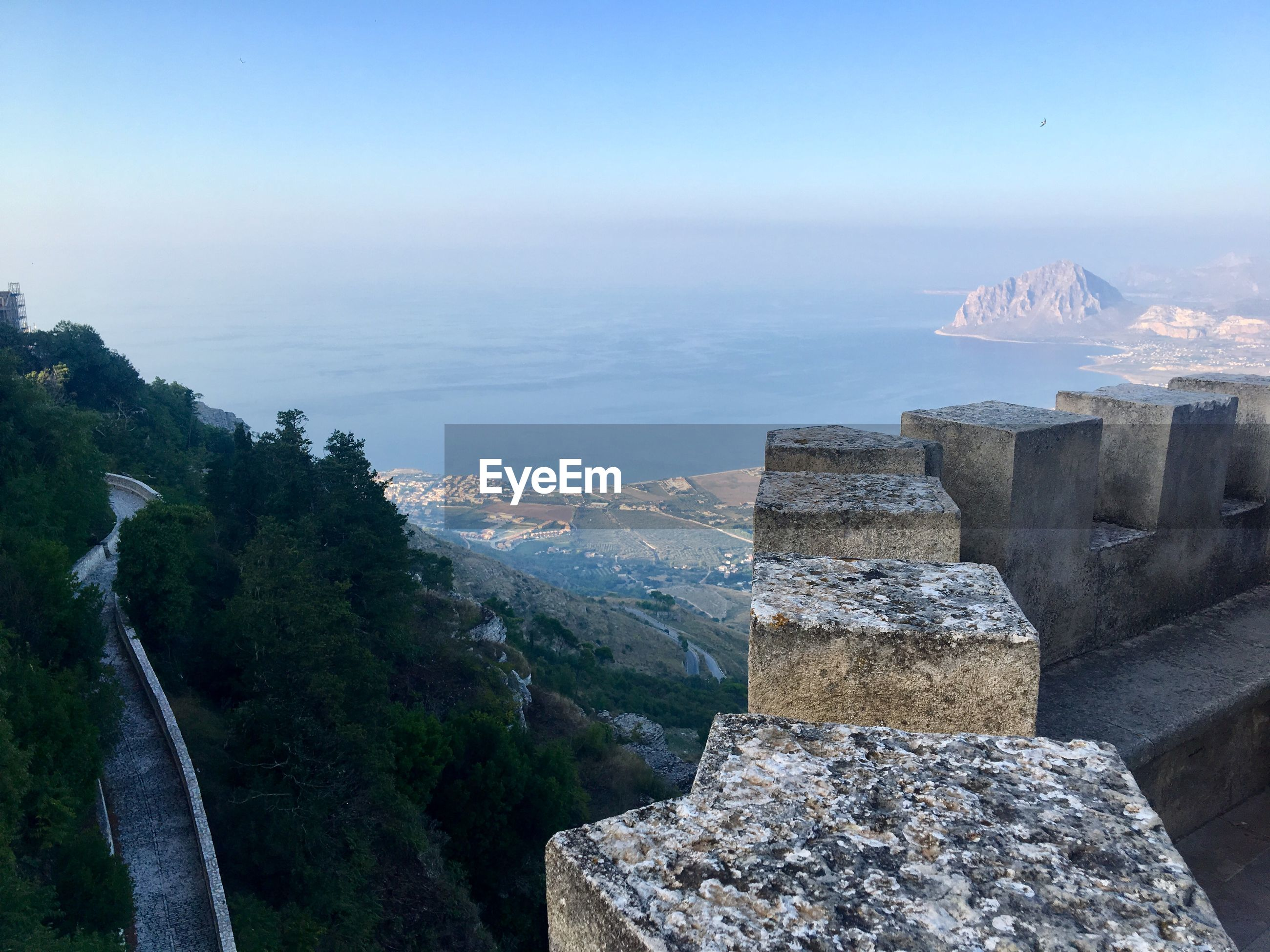 Panoramic view of sea and mountain against sky