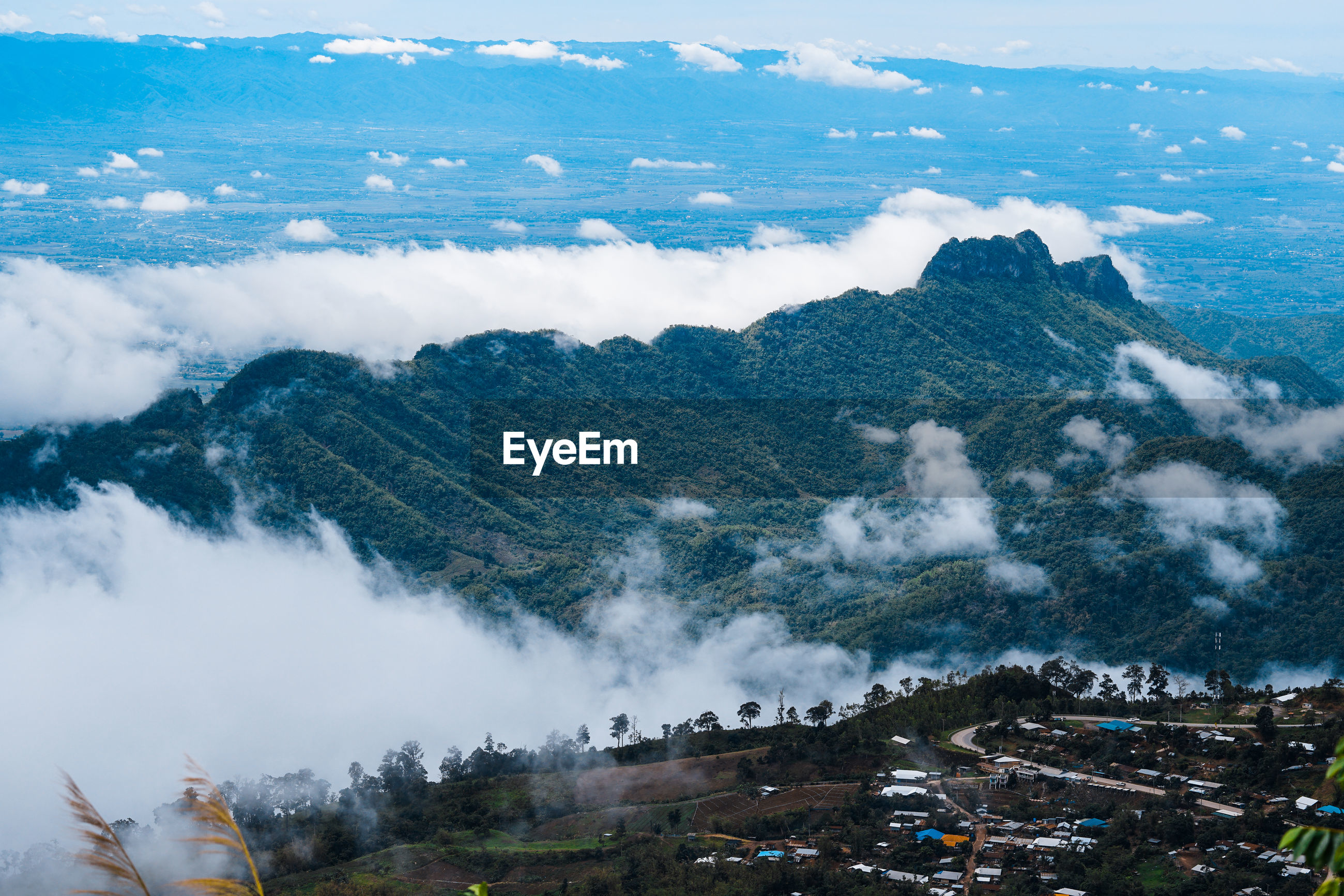 View of mountains during foggy weather