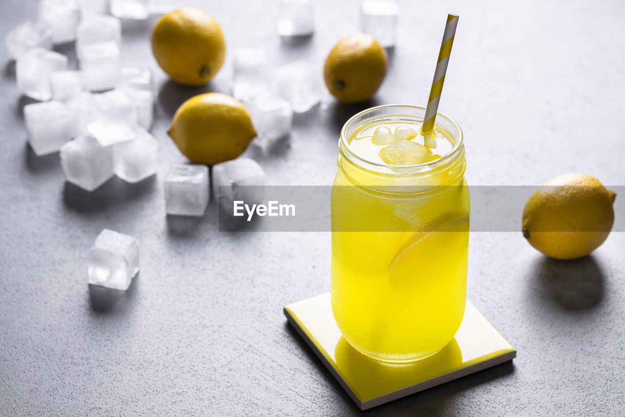 CLOSE-UP OF DRINK WITH FRUITS