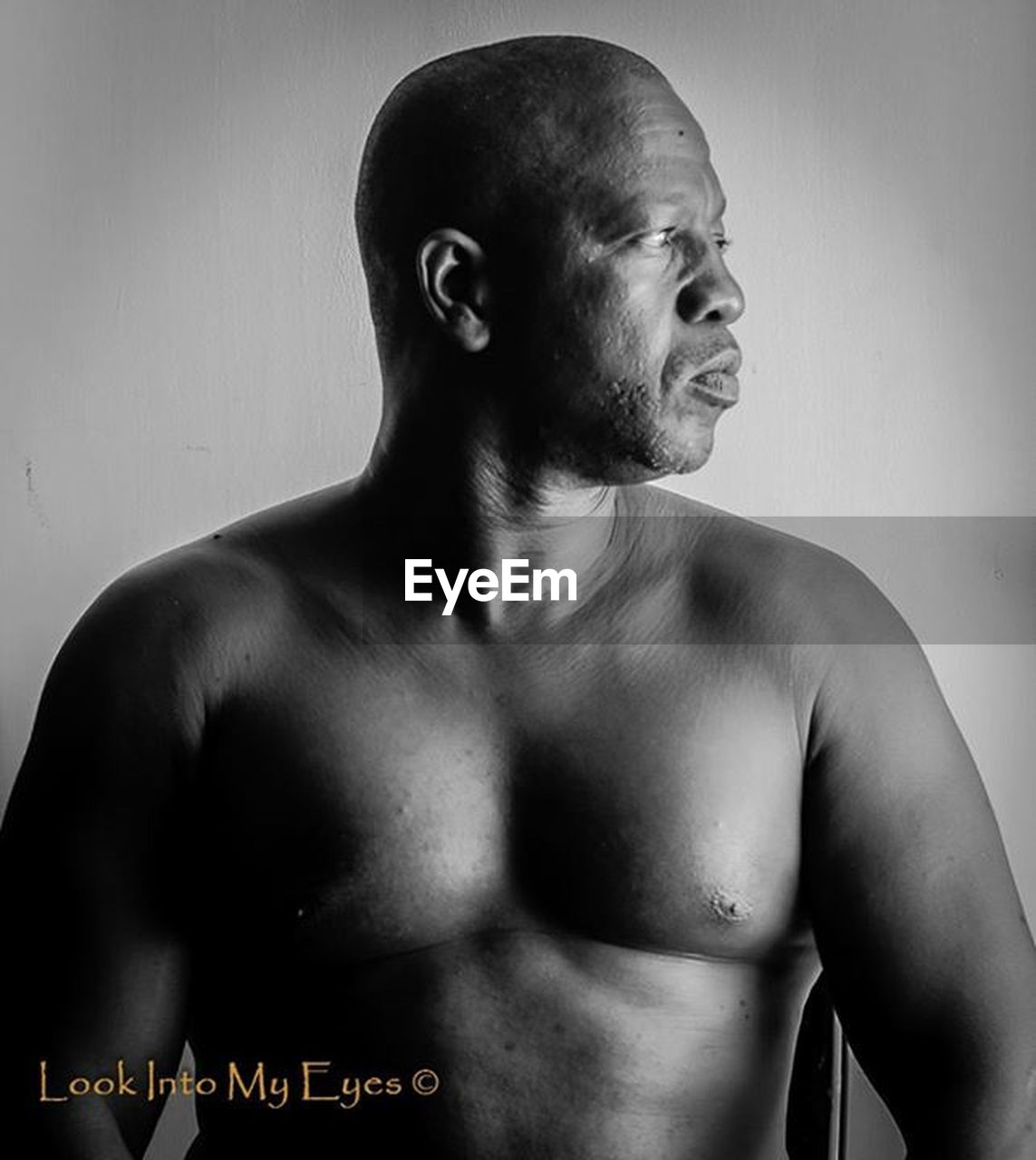 one man only, only men, shirtless, muscular build, shaved head, one person, men, adults only, adult, studio shot, completely bald, human body part, people, beard, masculinity, fashion model, indoors, real people, sportsman, human back, athlete, day