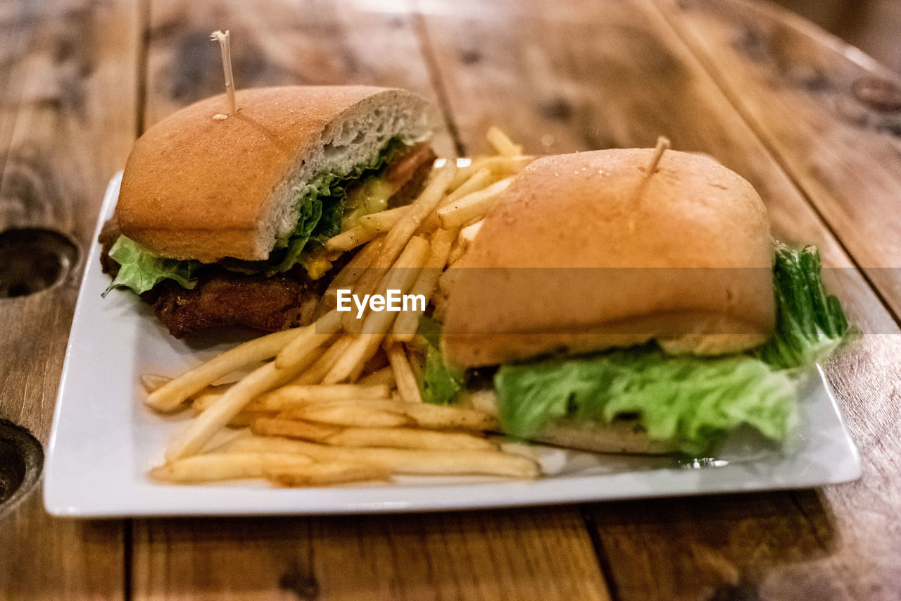 fast food, food and drink, food, sandwich, ready-to-eat, unhealthy eating, freshness, potato, french fries, prepared potato, bread, table, still life, burger, close-up, vegetable, indoors, hamburger, meat, take out food, no people, bun, fried, meal, snack, tray, temptation
