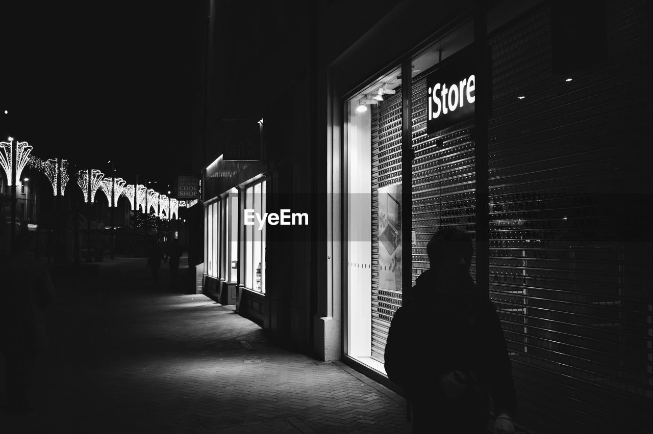 text, real people, communication, indoors, women, store, the way forward, built structure, architecture, night, one person, illuminated, people