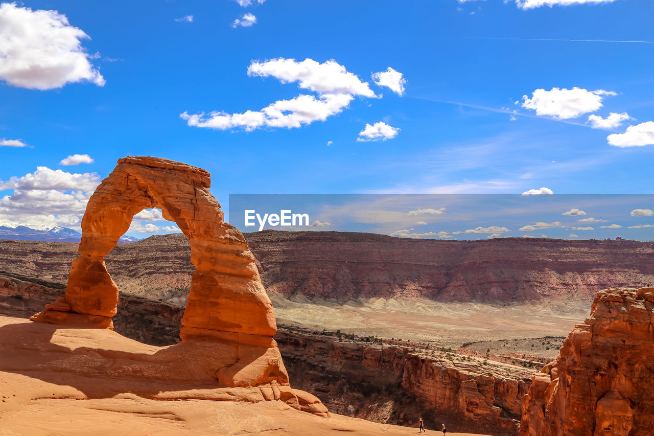 rock, rock formation, rock - object, sky, scenics - nature, cloud - sky, tranquil scene, solid, beauty in nature, physical geography, non-urban scene, tranquility, geology, landscape, nature, travel destinations, environment, remote, no people, blue, natural arch, arid climate, climate, eroded, outdoors, formation, sandstone