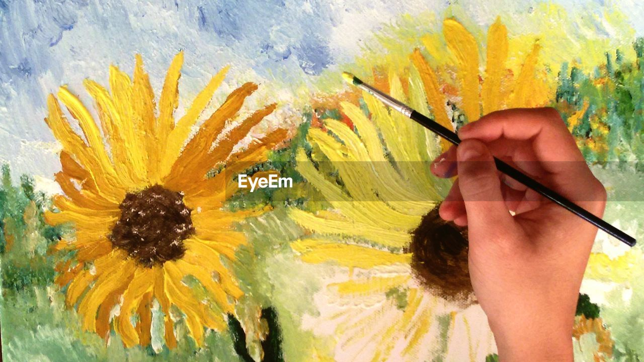 paintbrush, human hand, human body part, creativity, flower, painter - artist, art and craft, artist, holding, yellow, close-up, artist's canvas, one person, multi colored, palette, painted image, inspiration, oil paint, indoors, art studio, beauty in nature, nature, day, people, adult