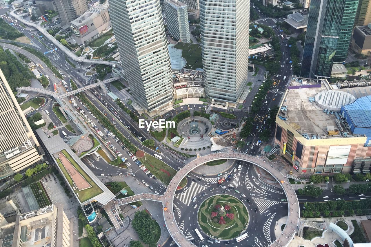 High Angle View Of Roads Amidst Buildings In City