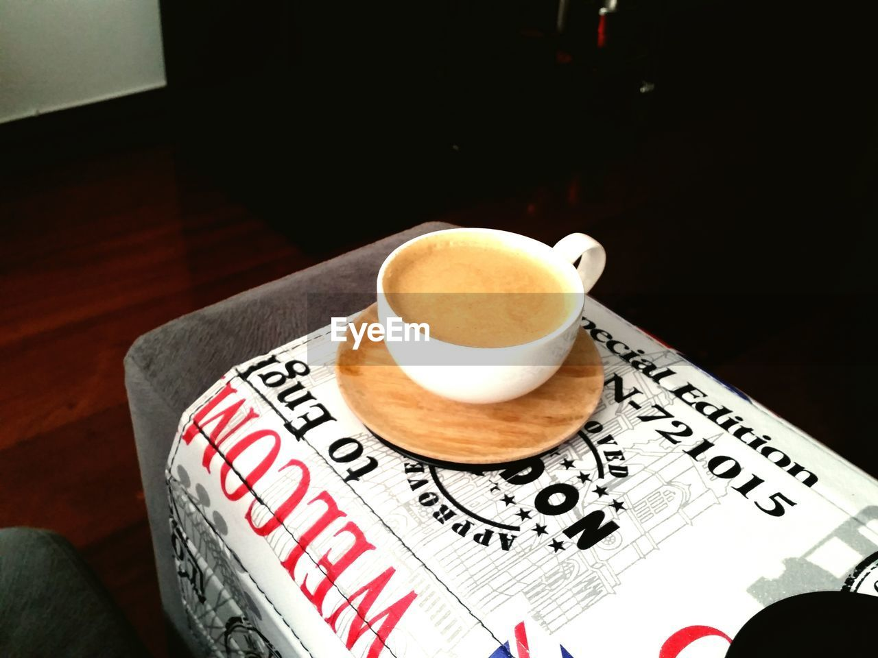 drink, coffee cup, coffee - drink, refreshment, table, food and drink, cup, text, indoors, frothy drink, high angle view, freshness, saucer, no people, cappuccino, close-up, froth art, day