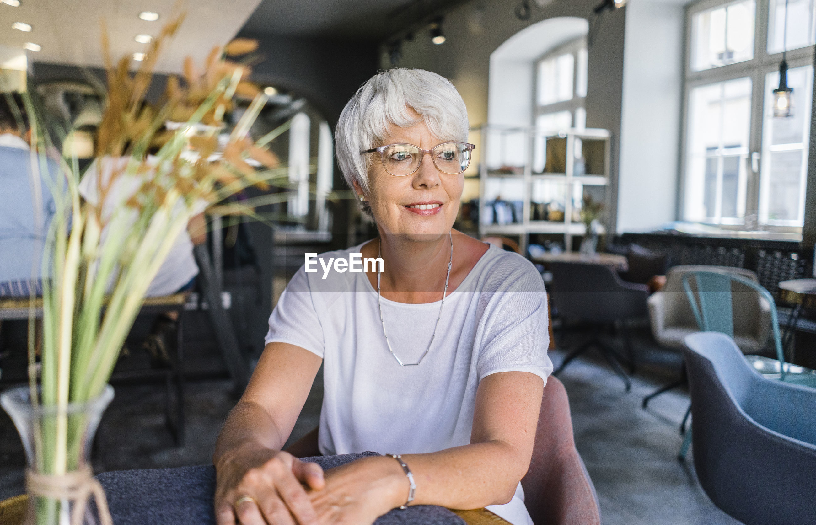 Thoughtful woman sitting in cafe