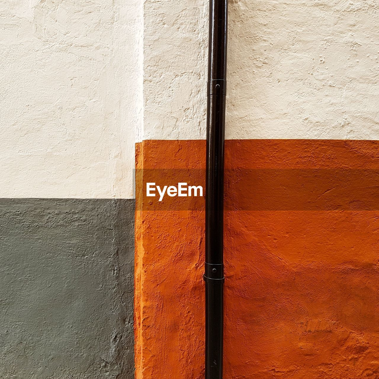 wall - building feature, built structure, architecture, building exterior, no people, day, close-up, textured, full frame, white color, outdoors, pipe - tube, backgrounds, orange color, wall, sunlight, wood - material, pattern, rough, safety, concrete
