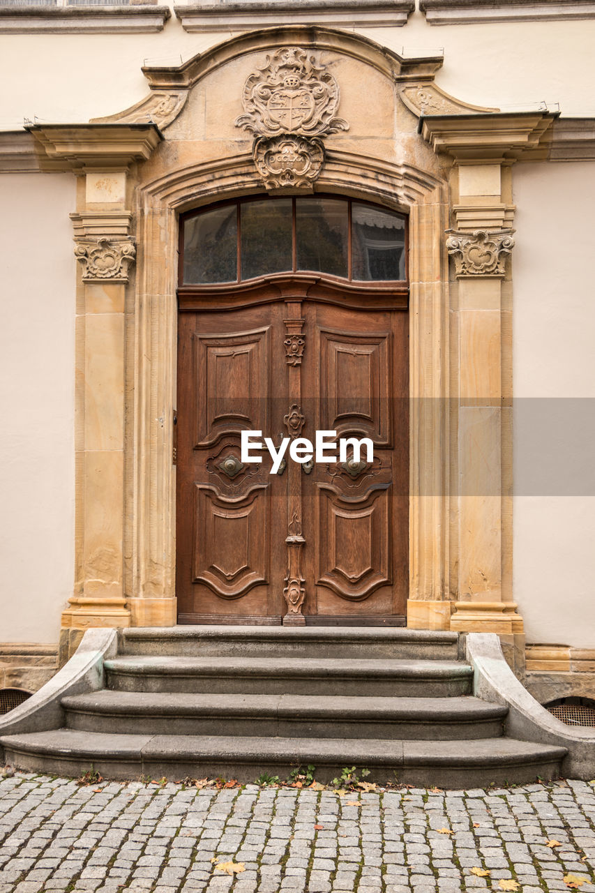 architecture, entrance, door, building exterior, built structure, closed, building, staircase, day, no people, history, the past, wood - material, front door, city, security, craft, carving - craft product, house, wood, outdoors, ornate, bas relief, carving