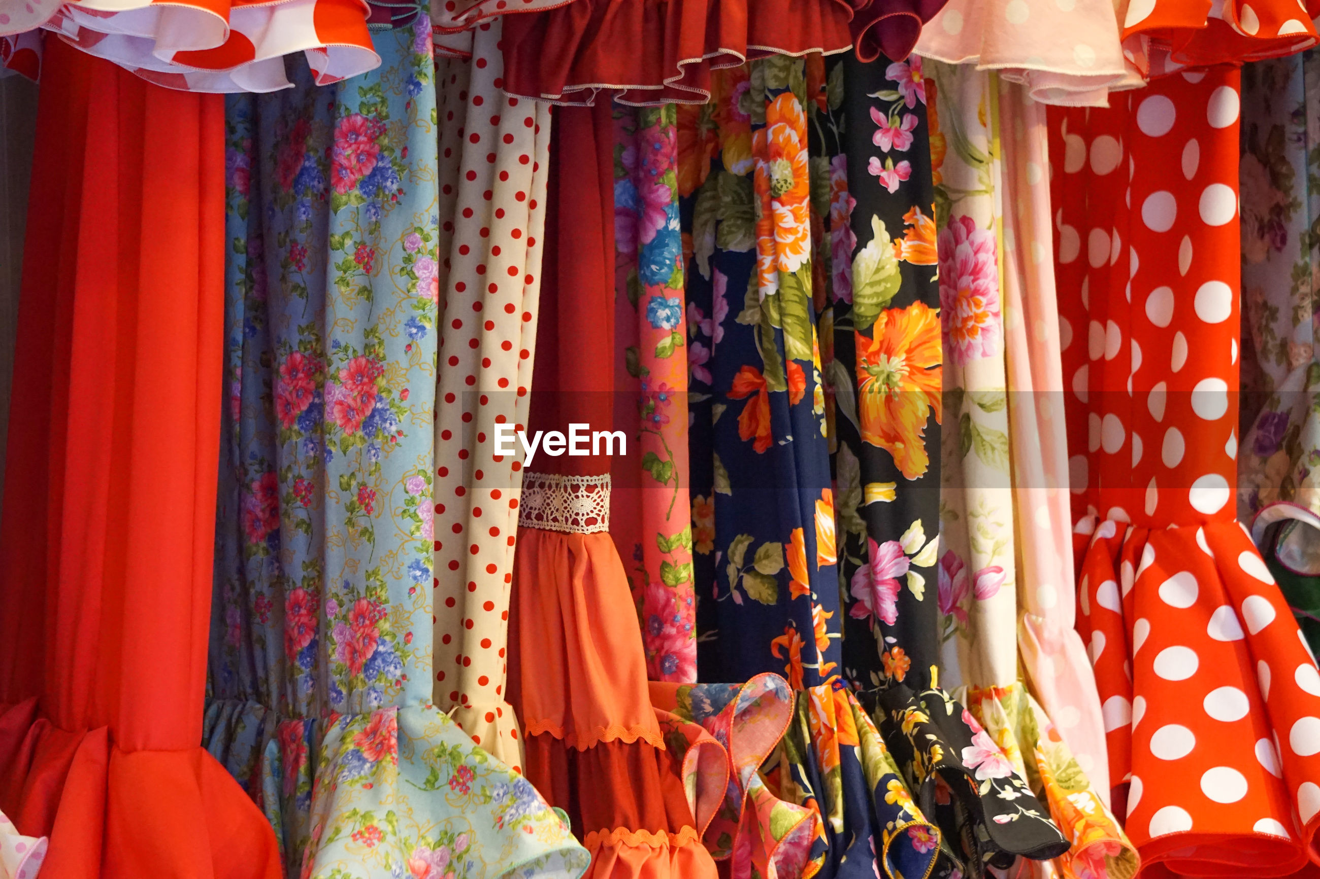 Dresses hanging in market for sale