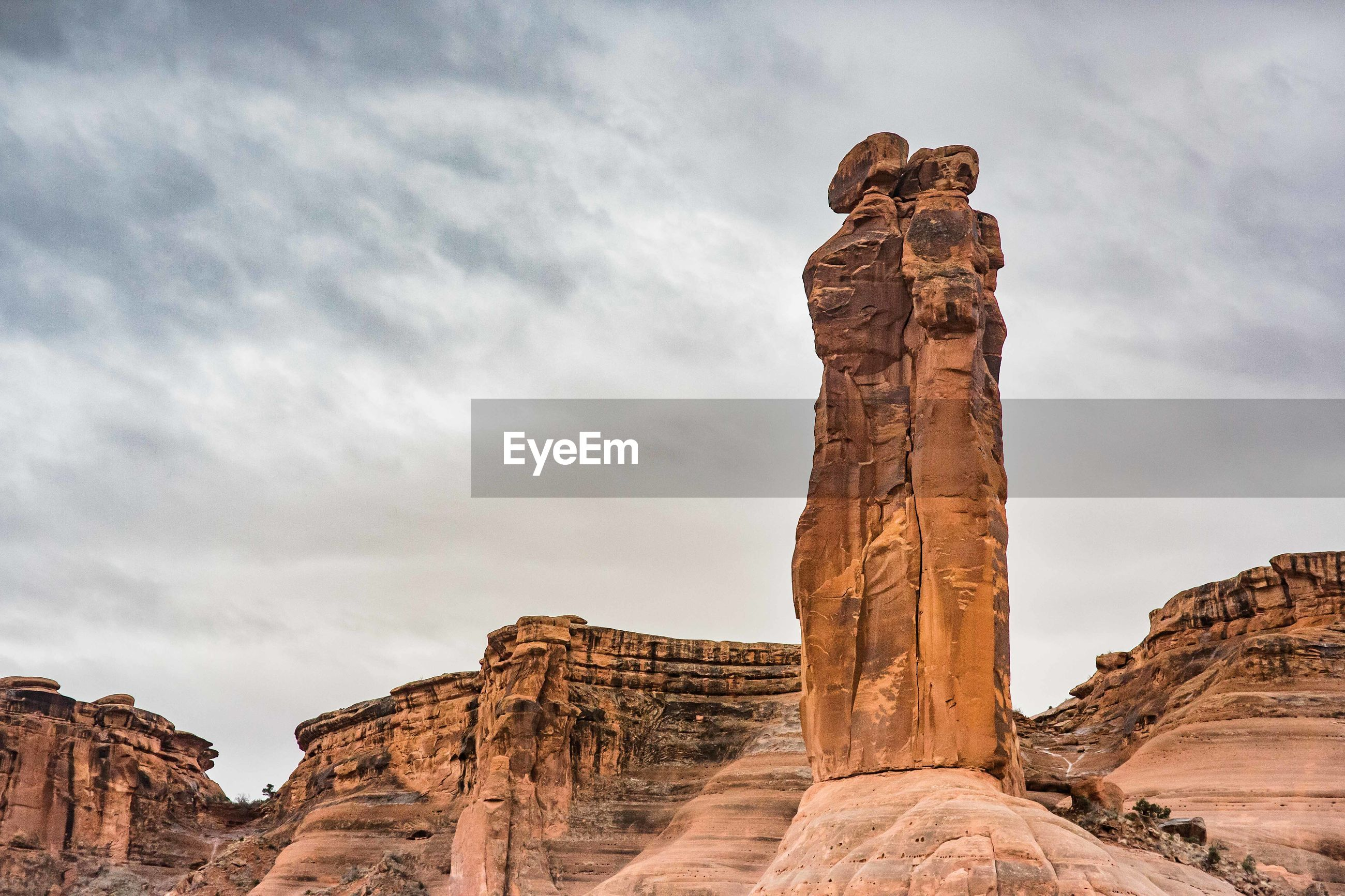 Low angle view of rock formations against sky at arches national park