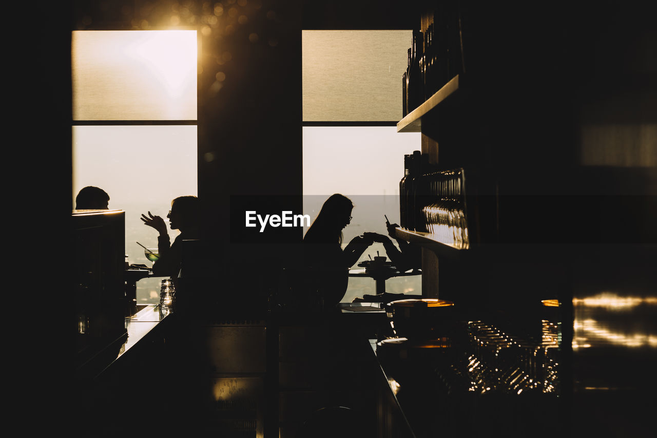 Silhouette Of People In Caf