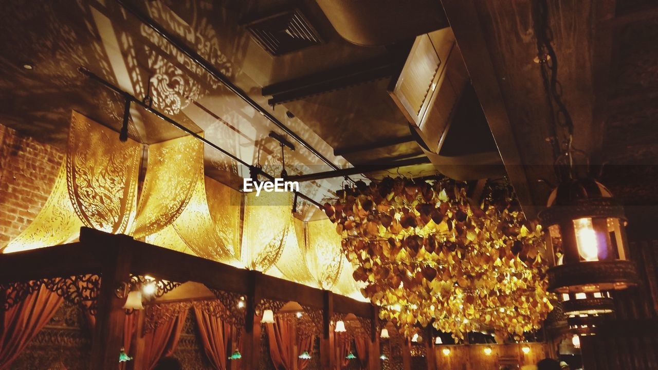 low angle view, illuminated, indoors, no people, hanging, night, architecture