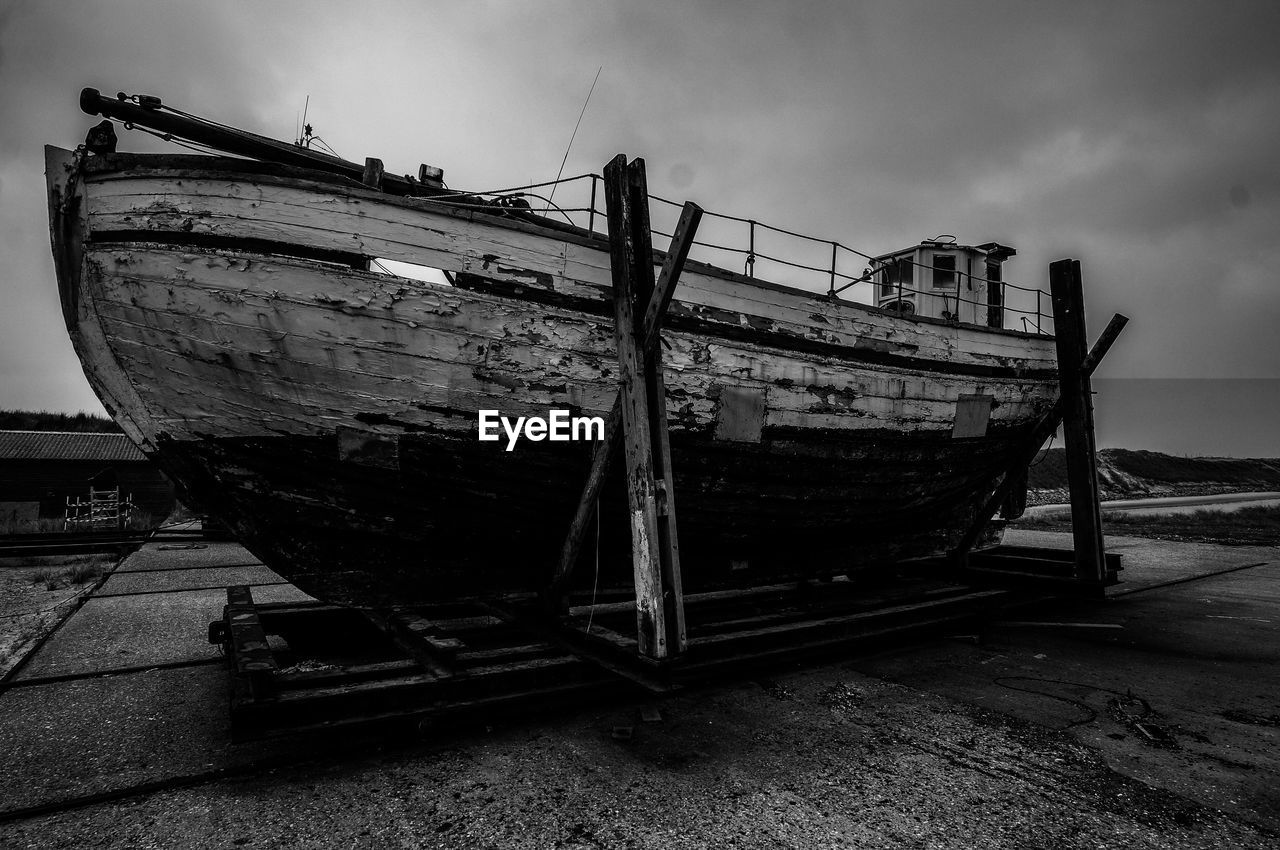 nautical vessel, transportation, sky, mode of transportation, abandoned, water, cloud - sky, ship, sea, nature, day, no people, moored, beach, old, land, outdoors, run-down, obsolete, deterioration, fishing boat