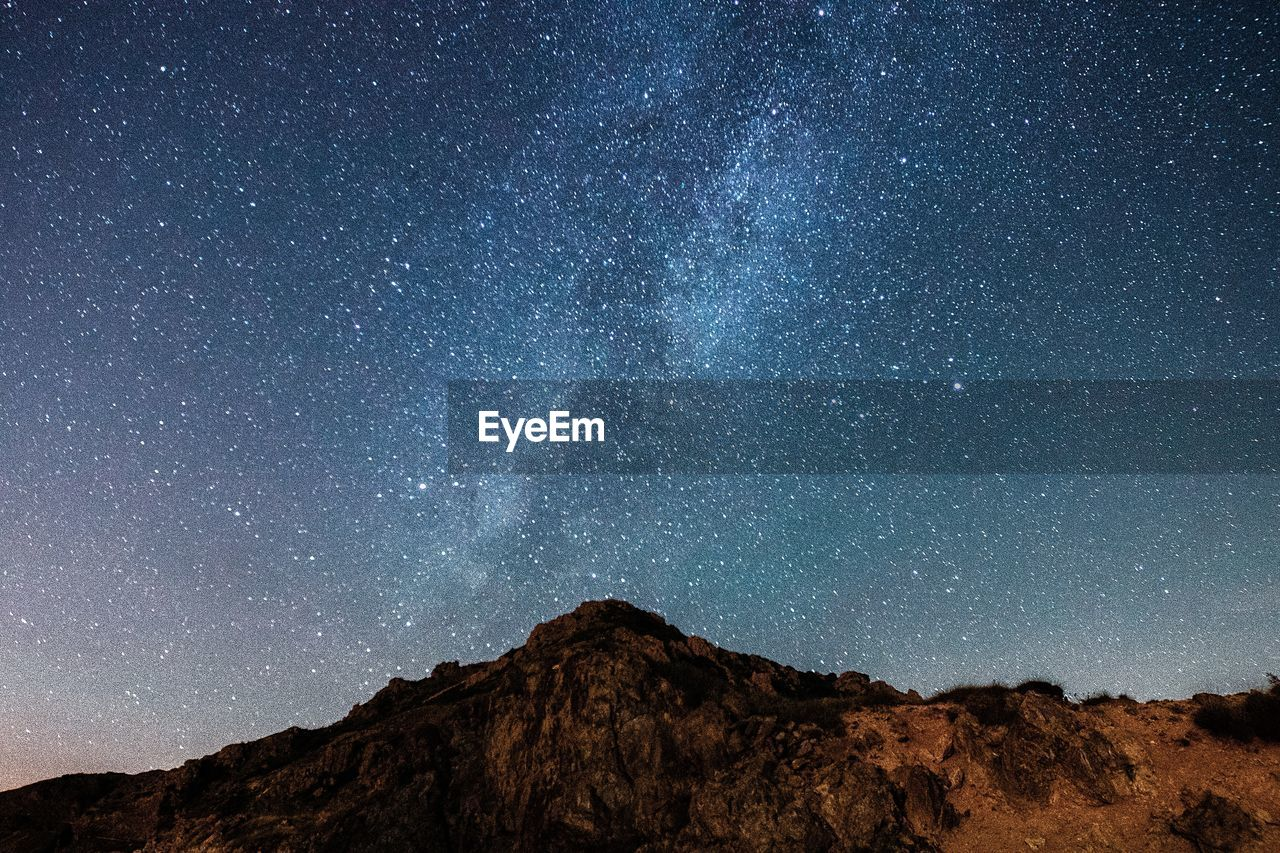 star - space, astronomy, space, night, galaxy, sky, beauty in nature, scenics - nature, mountain, nature, milky way, tranquil scene, environment, tranquility, no people, landscape, star, constellation, outdoors, low angle view