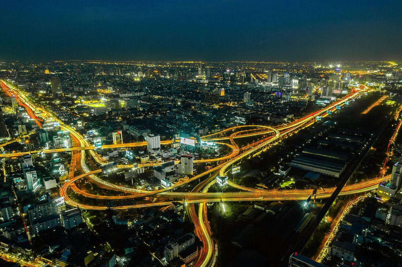 High Angle View Of Illuminated Roads In City At Night