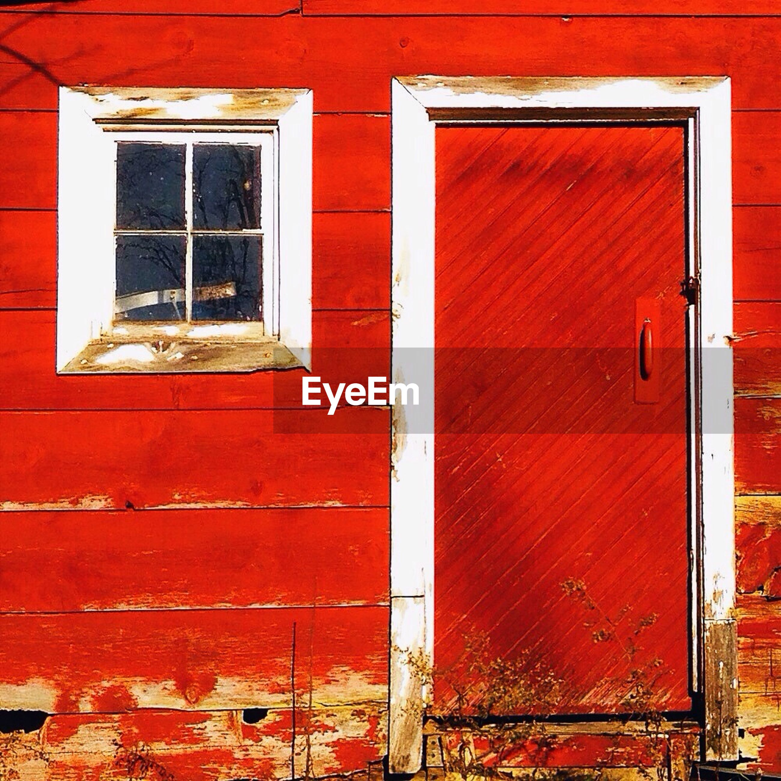 Exterior of old wooden red house