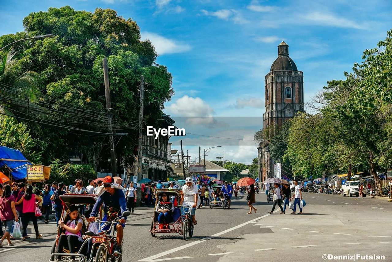 large group of people, architecture, built structure, real people, tree, building exterior, sky, day, cloud - sky, men, women, outdoors, leisure activity, city, nature, people, adult
