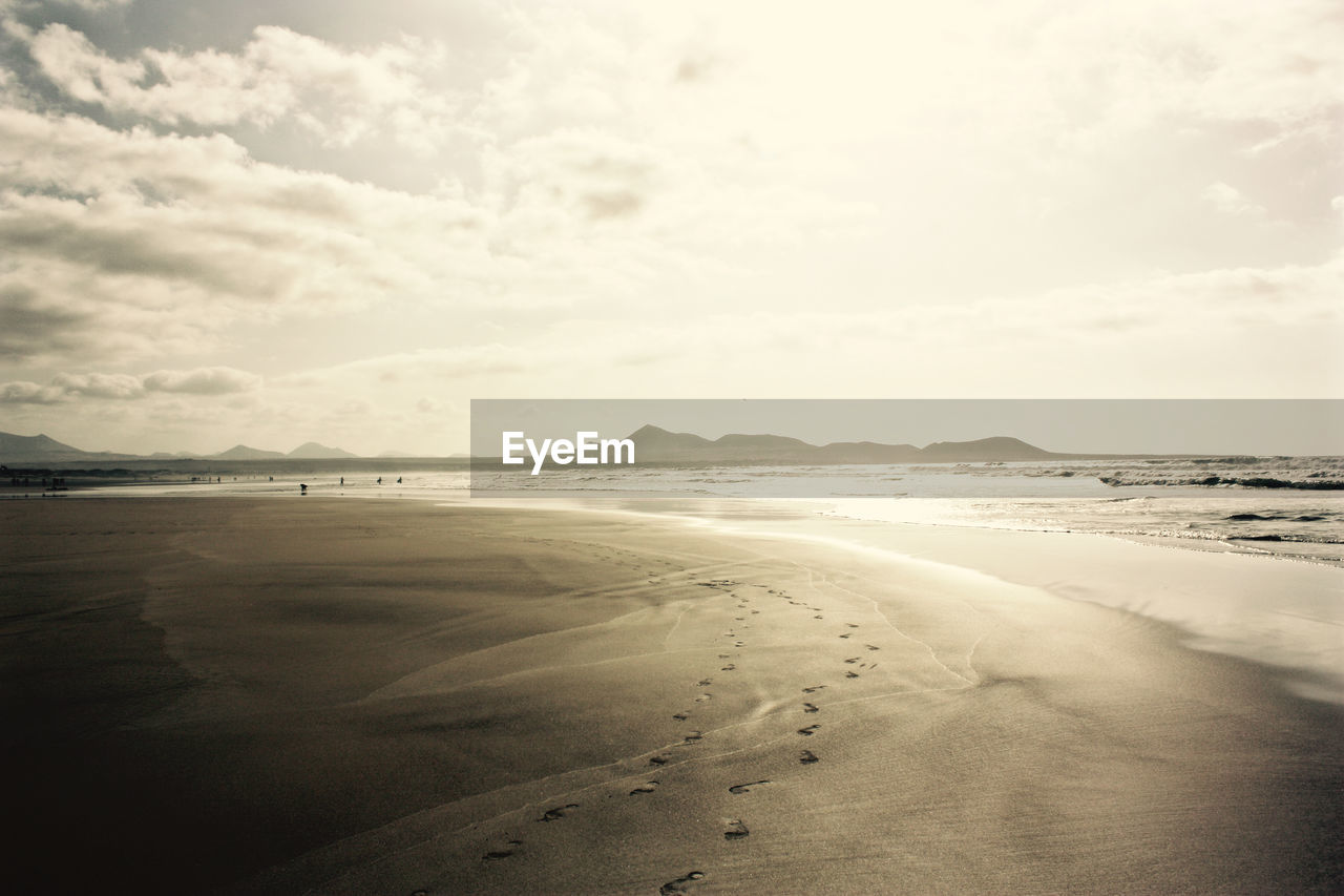 sky, cloud - sky, tranquility, beauty in nature, scenics - nature, tranquil scene, land, beach, nature, water, sea, sand, day, no people, non-urban scene, mountain, outdoors, idyllic, environment