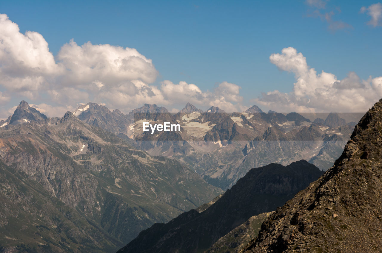 mountain, sky, cloud - sky, mountain range, environment, beauty in nature, landscape, mountain peak, scenics - nature, nature, tranquil scene, non-urban scene, no people, tranquility, idyllic, outdoors, day, rock, land, snow, formation, range, snowcapped mountain