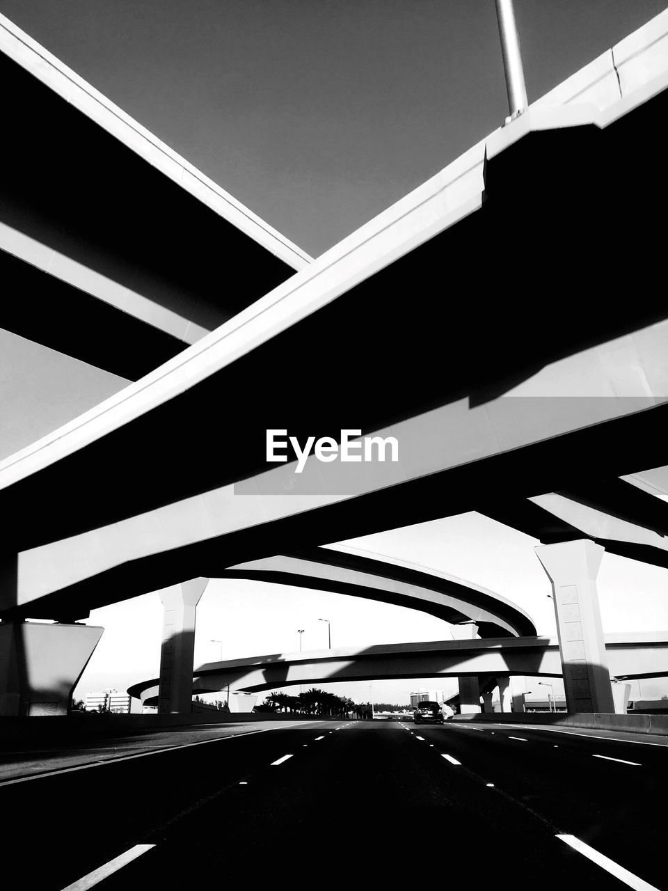 transportation, car, bridge - man made structure, road, mode of transport, land vehicle, highway, built structure, architecture, connection, car interior, day, windshield, street, car point of view, city, the way forward, low angle view, road sign, no people, road trip, outdoors, parking garage, close-up, sky