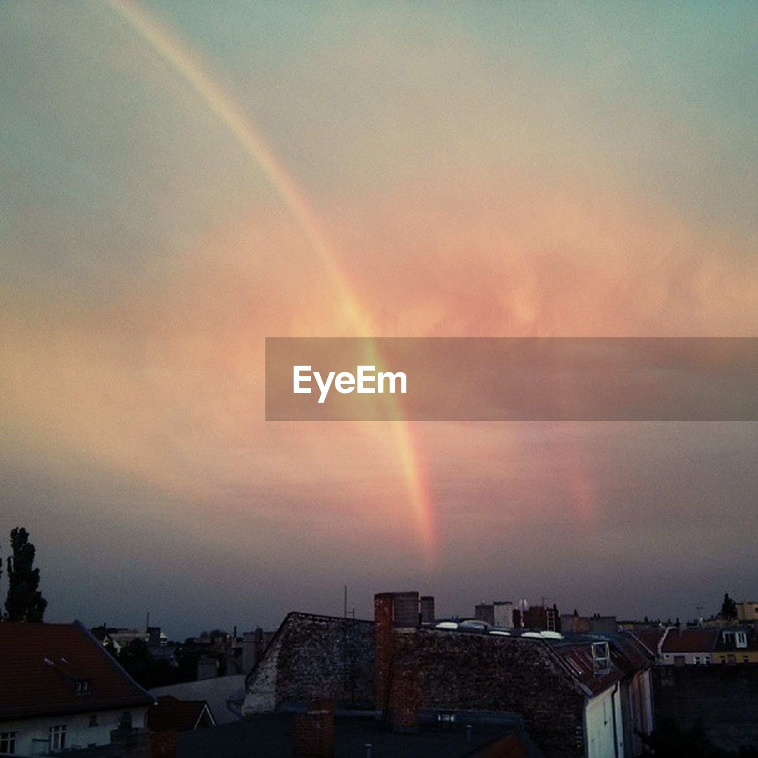 rainbow, sky, sunset, scenics, building exterior, built structure, beauty in nature, architecture, multi colored, cloud - sky, nature, tranquil scene, house, tranquility, idyllic, landscape, weather, outdoors, residential structure, no people