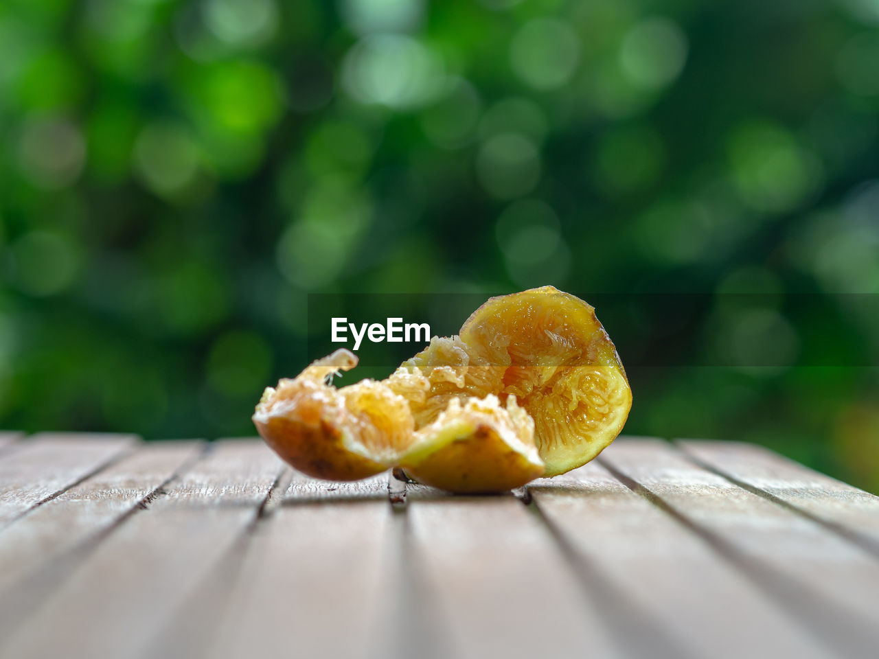 food, food and drink, selective focus, wood - material, close-up, table, freshness, healthy eating, day, no people, fruit, wellbeing, yellow, orange color, outdoors, nature, still life, sunlight, orange, ready-to-eat, surface level, temptation, snack