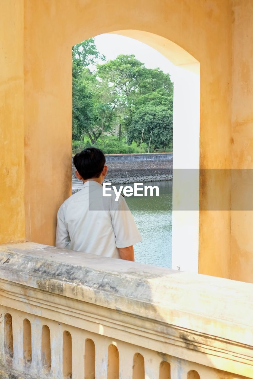 real people, rear view, architecture, built structure, architectural column, history, day, men, standing, lifestyles, one person, sitting, indoors, leisure activity, spirituality, building exterior, ancient civilization, water, tree, nature, sky