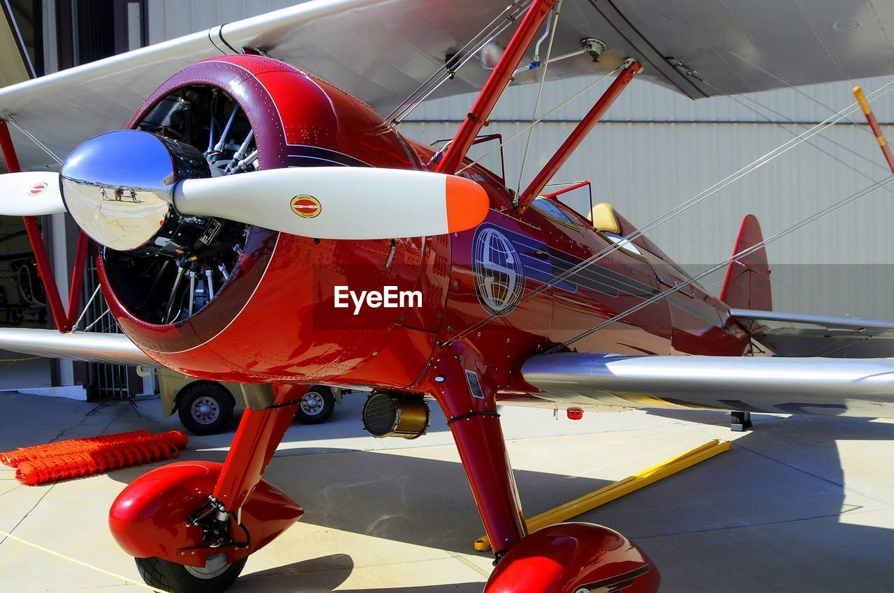 transportation, mode of transport, red, air vehicle, airplane, no people, day, stationary, nautical vessel, outdoors, close-up