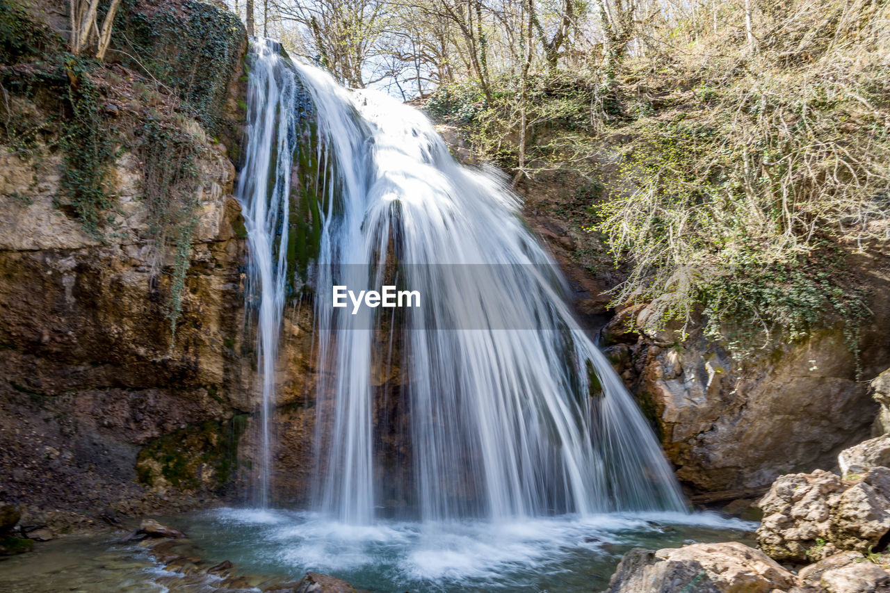 waterfall, scenics - nature, water, rock, beauty in nature, motion, solid, rock - object, long exposure, land, forest, flowing water, environment, tree, blurred motion, nature, plant, flowing, non-urban scene, no people, outdoors, power in nature, stream - flowing water, rainforest, falling water