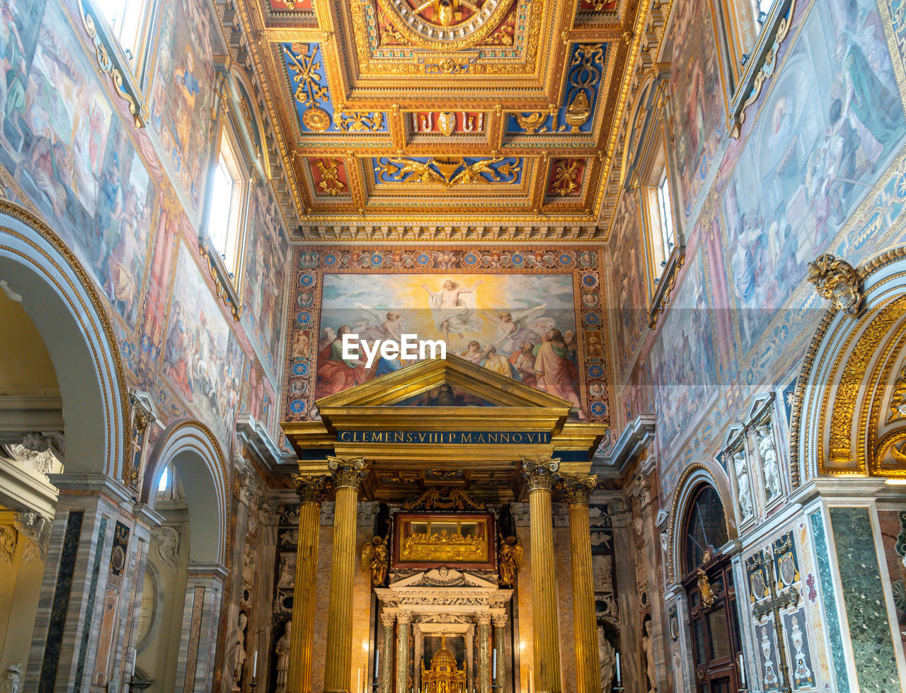 built structure, architecture, religion, belief, place of worship, low angle view, travel destinations, building, spirituality, art and craft, indoors, no people, history, ornate, the past, ceiling, architectural column, mural, altar, fresco
