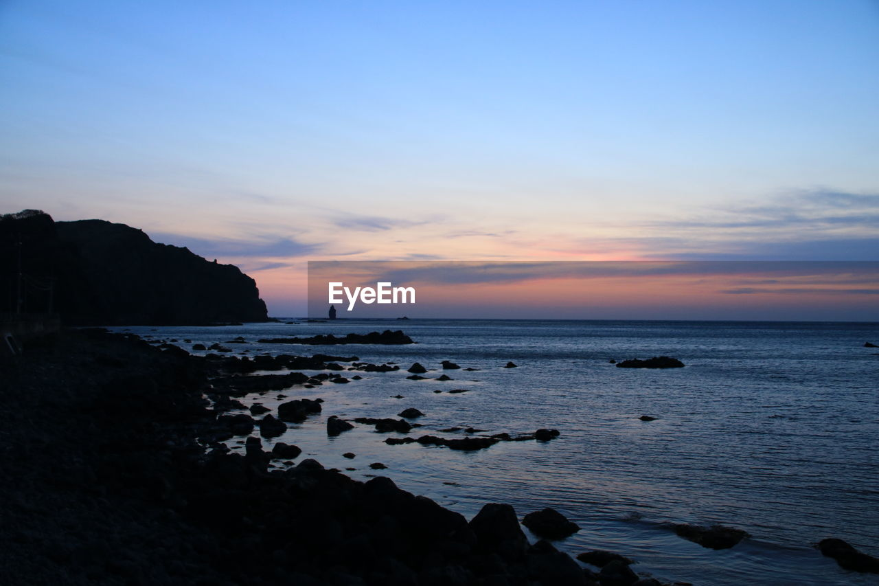 sky, water, sea, sunset, scenics - nature, beauty in nature, beach, rock, land, horizon over water, horizon, solid, rock - object, tranquil scene, tranquility, cloud - sky, nature, idyllic, no people, outdoors, rocky coastline
