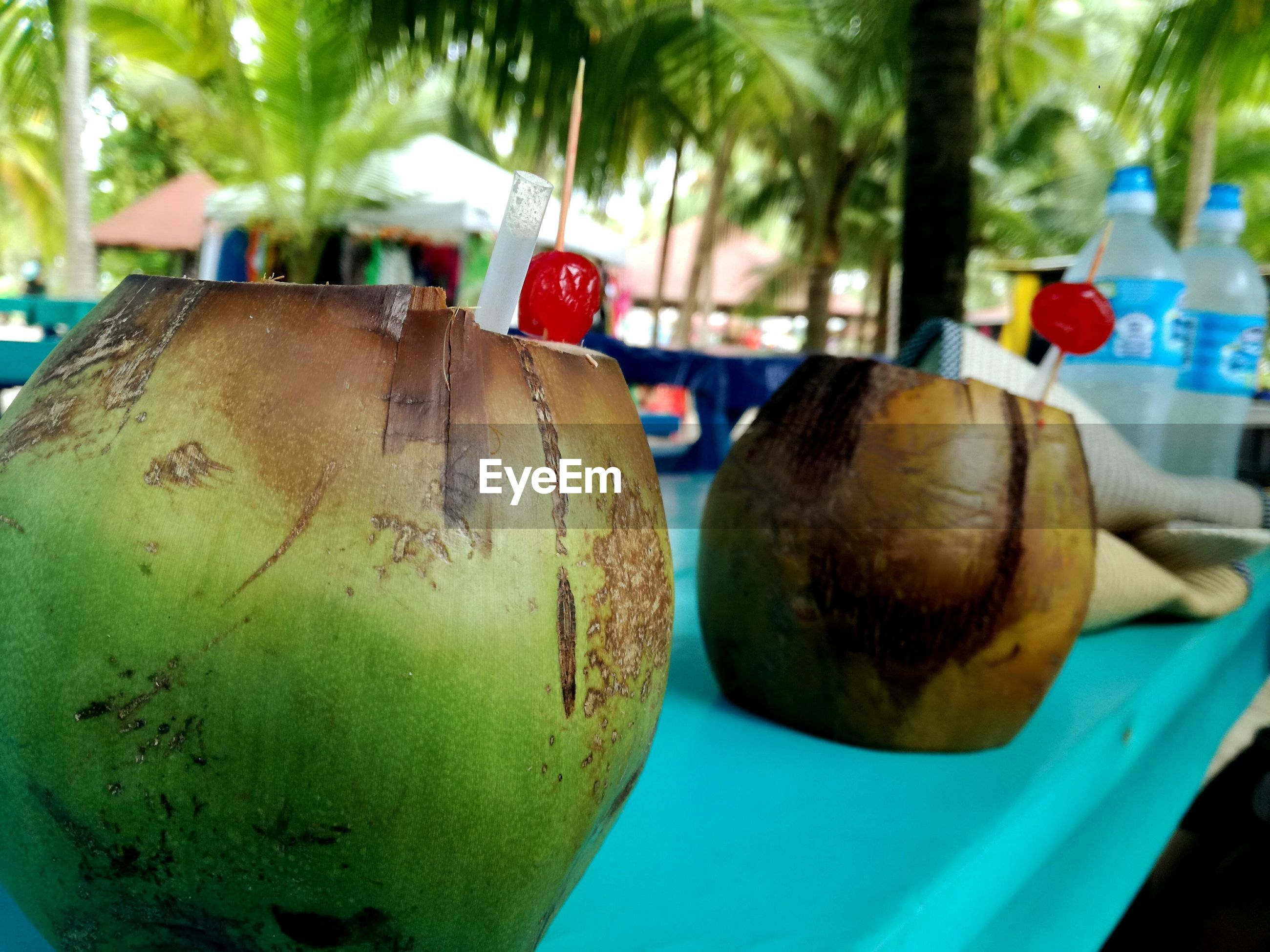 no people, food and drink, focus on foreground, close-up, fruit, food, day, outdoors, green color, healthy eating, tree, freshness, coconut, nature, ready-to-eat, sky